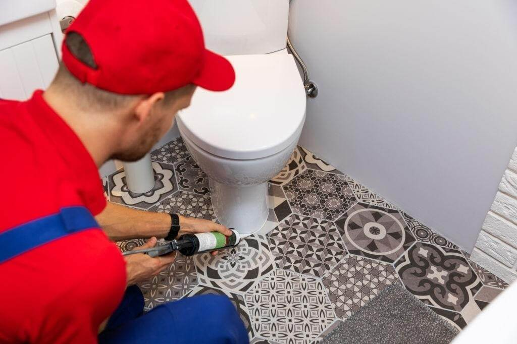 Install and then caulk the toilet